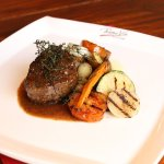 Our Wagyu tenderloin with our grilled vegetables and black pepper sauce.