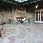 Outside fireplace and rockers