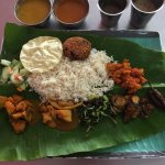 vegetarian banana leaf with payasam and vegetarian nasi lemak for breakfast and dinner