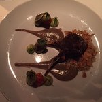 grilled lamb cutlets , almond cous cous , zuchini ribbons