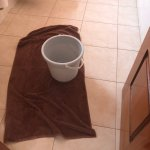 The bucket which the maid kindly left to catch the leaking water... for 4 days.