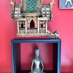 Spirit house and buddha statue