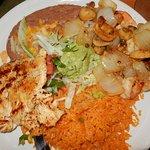 Veracruz combo: Chicken, shrimp, rice, mushrooms, onions, re-fried beans, lettuce, salsa.