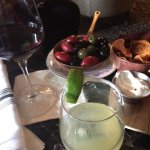 Margarita, local wine, olives, chips