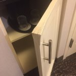 Room could use a new mini-bar door