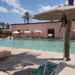 Views of black sand beach, hotel room, solarium and swimming pool. Refer to my review for detail