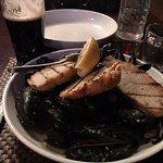 Thai mussels with grilled bread -- over 40 shells!