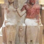 A charming Egyptian statue of a married couple