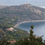 the view from surrounding hills to Il Pellicano located below in the first plan