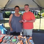 Author buying carving during IHOS Aboriginal Days