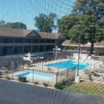Sorry for view through screen. Shows size and location of pool.