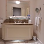 Large bathroom with night light and marble floors