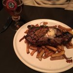 Steak topped with mustard seeds & butter and side of chips
