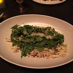 Pasta dish with pine nuts & rocket