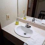 Bathroom sink. Soap in a hand pump.