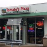 front of & entrance to Tomato's Pizza