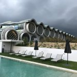 View of the hotel and pool area with a storm brewing in the background