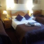 Family room. Clean and very spacious. Double bed and two singles.