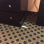wedged under dresser to keep level.