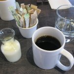 Milk, or cream, comes in a little decanter to go with coffee, or tea.