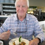 Reviewer, George Czerny, enjoys his dessert at Oliver & Bonacini, Blue Mountain.