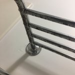rusty underside of towel rack