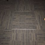 Separated floor tiles with sticky tape showing