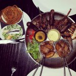 20oz Mixed grill for two. Ceaser salad and onion rings.