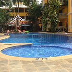 This is the pool side in which they put sun beds out behind is a restaurant and the rooms run fr