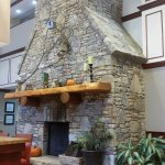 Stone fireplace in breakfast room.