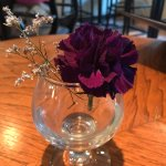 Lovely touches of real flowers on tables, Giovanni's Ristorante & Lounge, Qualicum Beach, BC