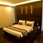 King size bed and bathroom behind