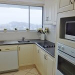 Fully equipped kitchen with dishwasher, microwave
