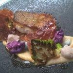 Roast cod with shards of crispy prosciutto