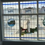 Stained glass windows of ships and lighthouses
