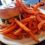 Delicious burger with sweet potato fries