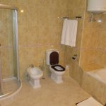 Shower stall and toilet in room ME 204.