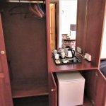 Closet and fridge in room 102.