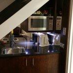 King loft kitchenette under the stairs