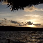 View of sunset from hammocks on pier