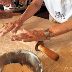 Rolling out the roti dough.