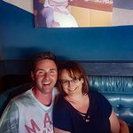 Our photo taken in front of Nicks photo. Cute idea by our waitress.