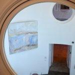 Through the round window.