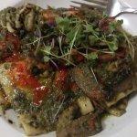 Vegan ravioli, vegan sorbet, vegan bread and oil, flattened chicken