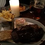Beef rib with pulled pork and fries and slaw.