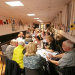 56 dine together in the skittle alley - probably room for a few more.