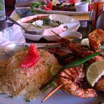 Charcoal grilled prawns in foreground and charcoal grilled fish (basa) at top of photo