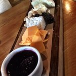 Cheese flight with almonds and berries