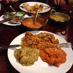 Pictured is Biryani(rice), Butter Chicken and Kerala Prawn Curry