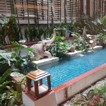 small pool garden in front of hotel lobby